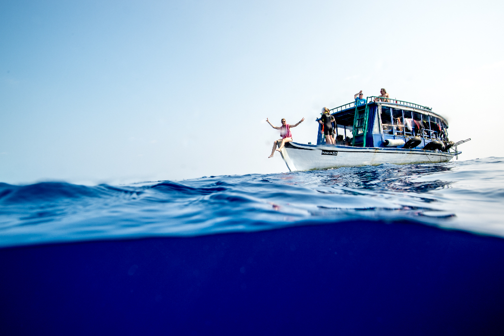 Having fun on the safety boat (or 'dhoni') (image courtesy of Emperor Maldives)