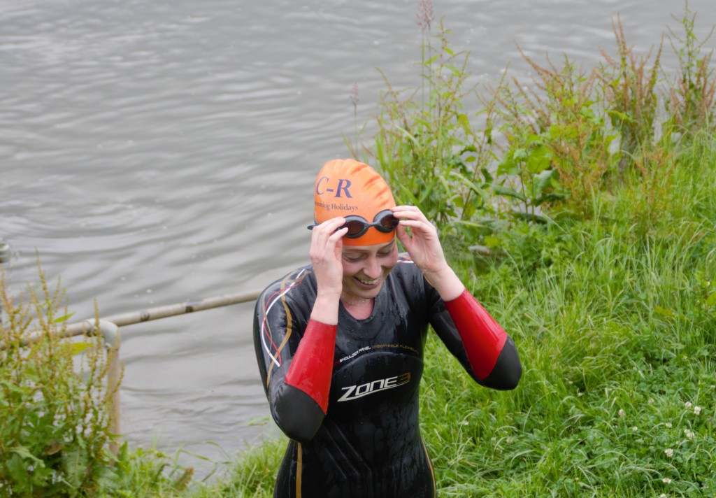 A happy swimmer finishes at Bury