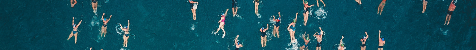 aerial view of people swimming in open water